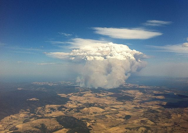 Aerial view of fire at Copping/Forcett at around 4pm on 4 Jan 2013 - view from window of an airplane leaving Hobart Airport.
